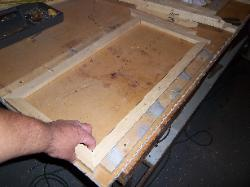 Canvas frame in holding jig
